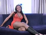 Hot ebony tranny poses on blue sofa