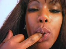 Tempting ebony shemale makes oral