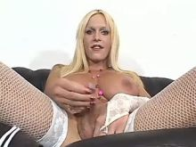 Blond shemale with big tits tempts guy